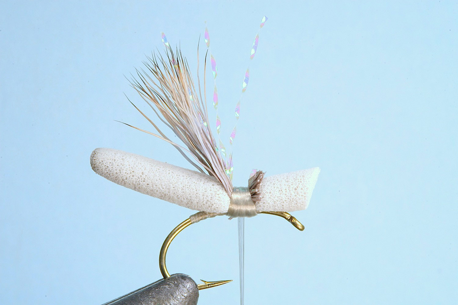 Showing step 4 of tying sequence for hot foam hopper fly pattern