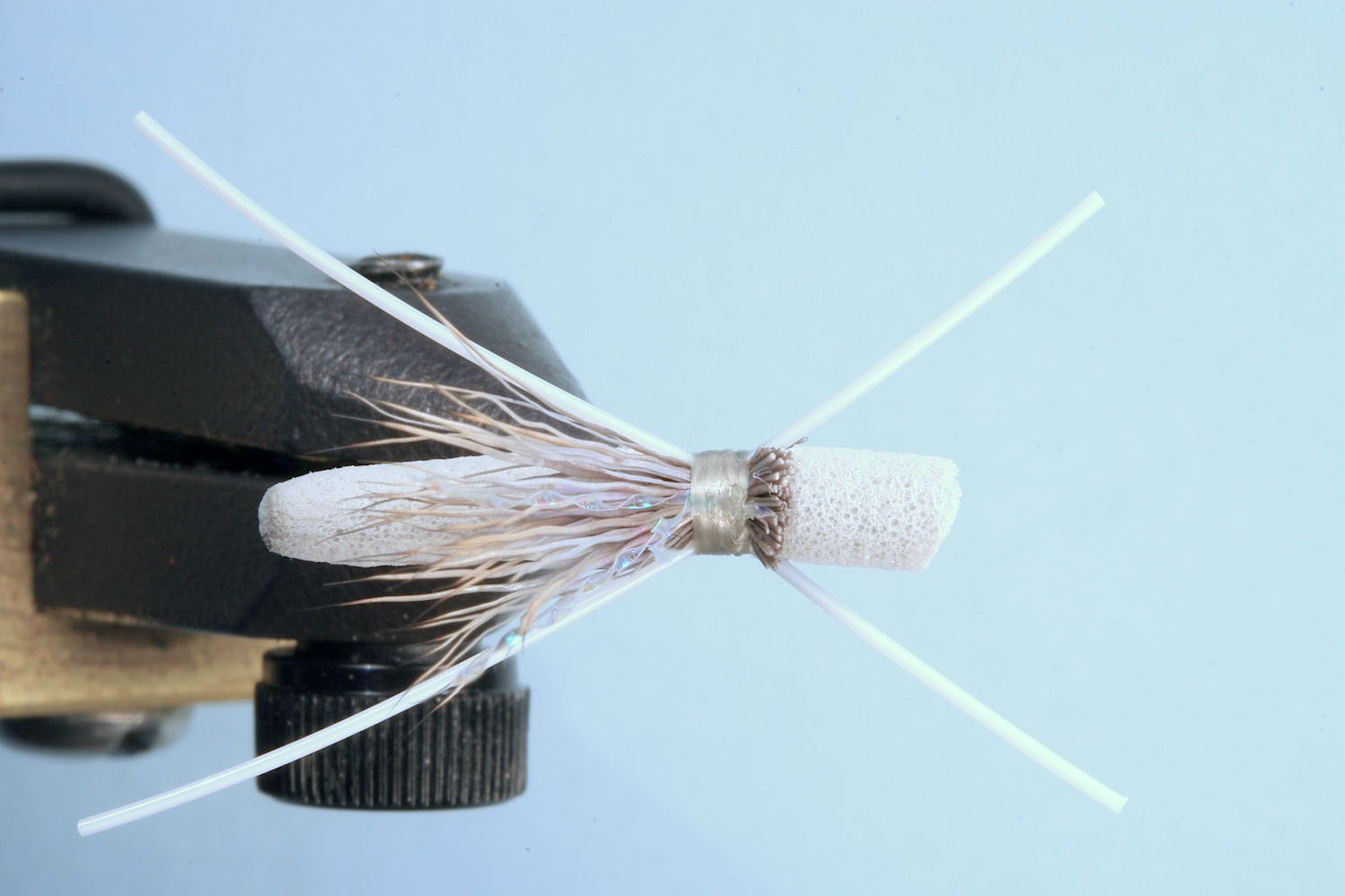 Showing step 5 of tying sequence for hot foam hopper fly pattern