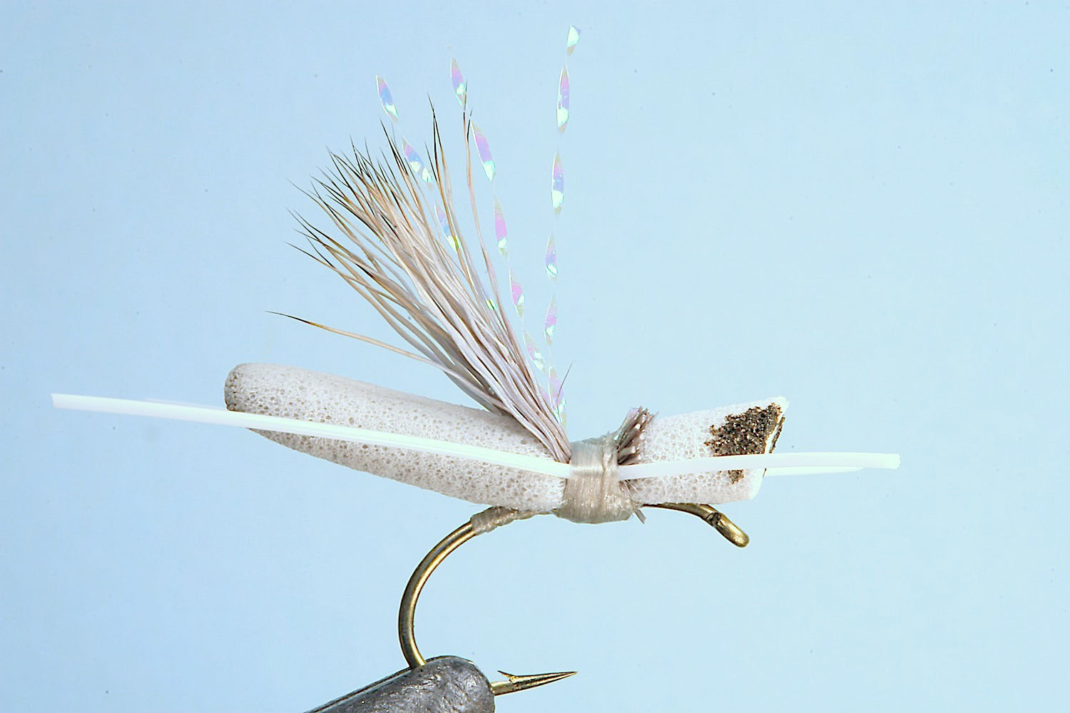 Showing step 6 of tying sequence for hot foam hopper fly pattern