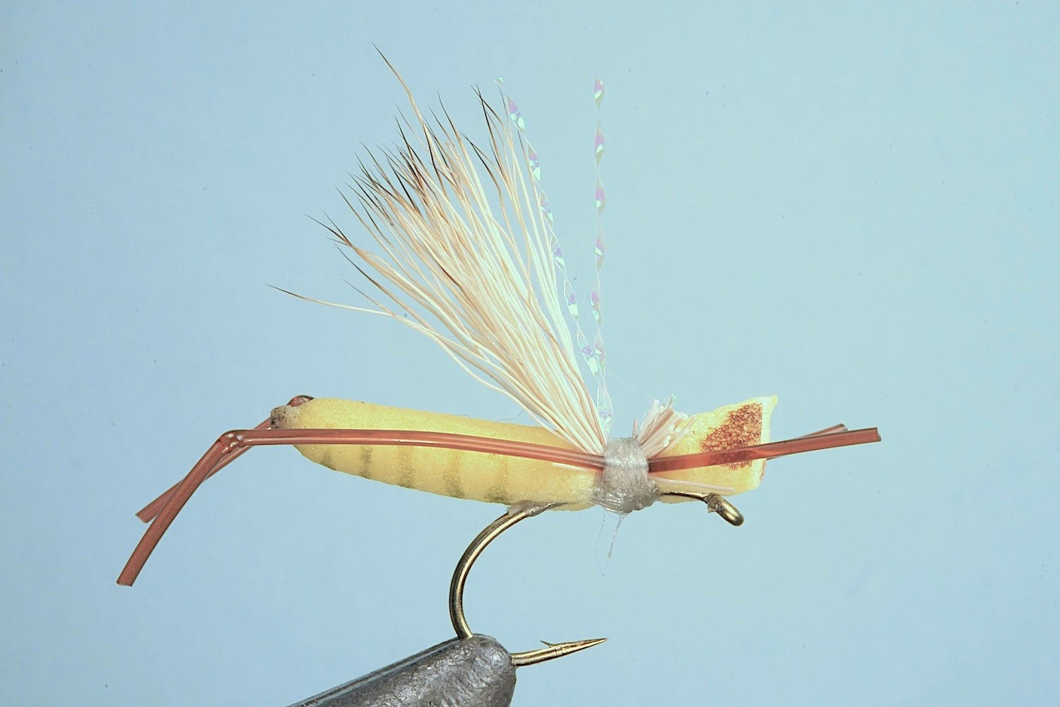 Showing step 7 of tying sequence for hot foam hopper fly pattern